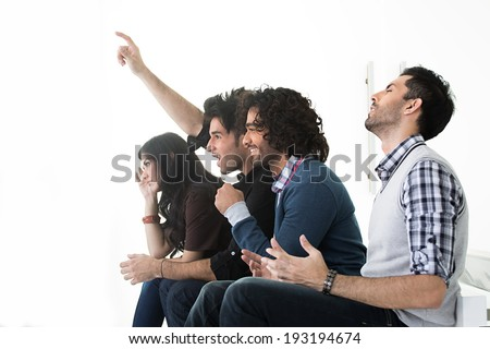 group of friends with mixed gestures while watching a match - stock photo