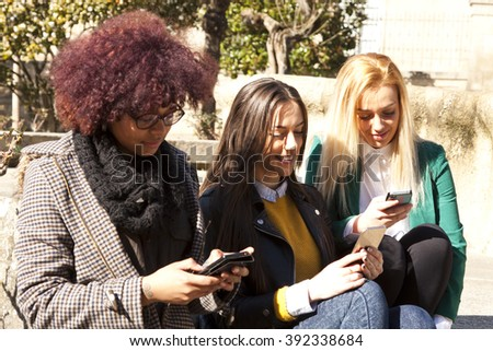 group of friends with mobile phone - stock photo