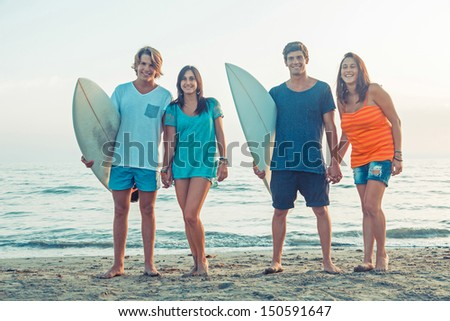 Group of Friends with Surf Boards