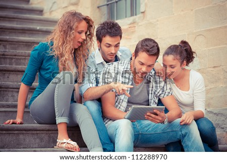Group of Friends with Tablet PC - stock photo
