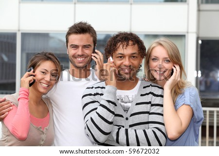Group of friends with telephone