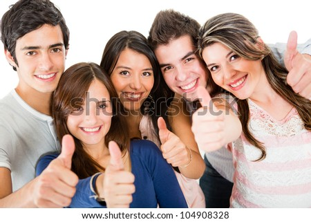 Group of friends with thumbs up - isolated over a white backgorund