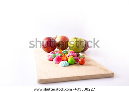 Group of fruit candy and marmalade, red and green apples and red oranges