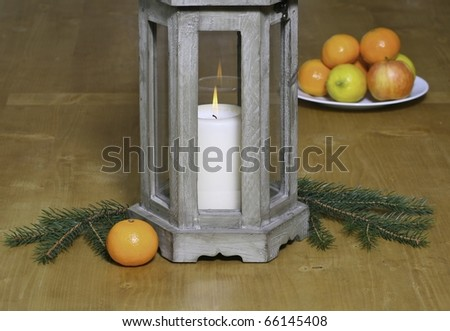 Group of fruits with a candle on a table