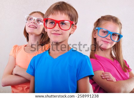 group of funny cute kids with eyeglasses posing - stock photo