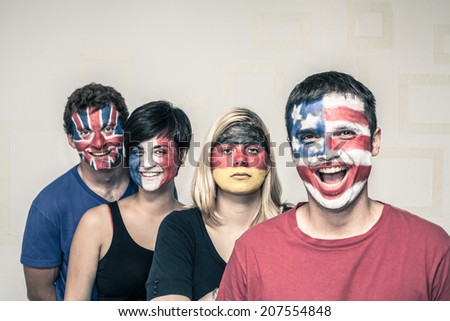 Group of funny people with painted flags on their faces.