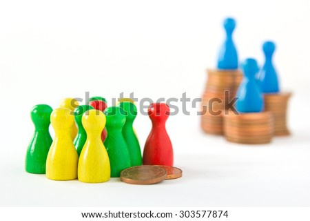 group of game figurines huddling around two cents while very few are on top of stacks, concept: unequal distribution of wealth