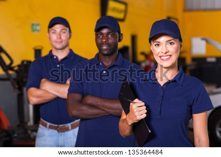 group of garage workers portrait - stock photo