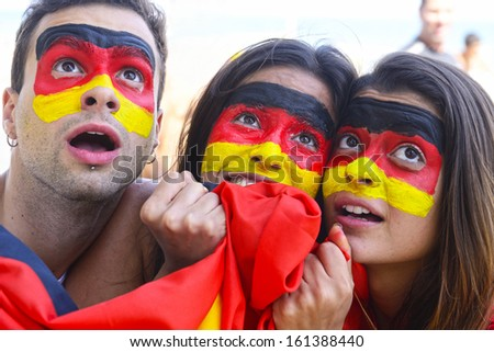 Group of German soccer fans concerned. - stock photo