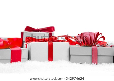 Group of gifts with colorful ribbons on white background; white space for text - stock photo