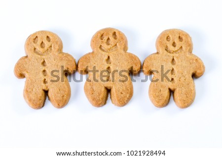 group of gingerbread man standing together on a white background