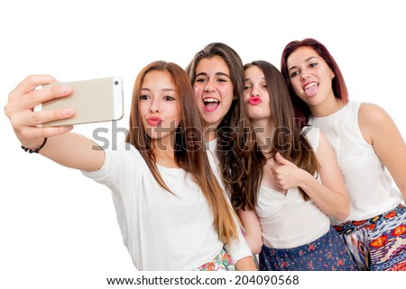 Group of girlfriends taking self portrait.Isolated on white background. - stock photo