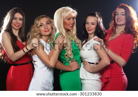Group of girls  friends having fun on a disco - stock photo