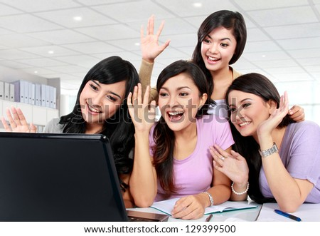 group of girls playing with laptop camera