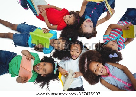 Group of girls reading books against a white background