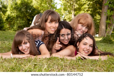 group of girls teenagers in park on grass
