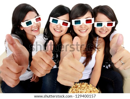 Group of girls watching movie showing thumbs up