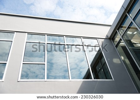 Group of glass windows on modern building. - stock photo