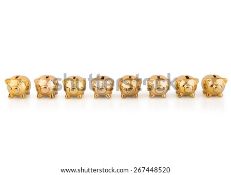 group of gold Piggy Banks in a  row - stock photo