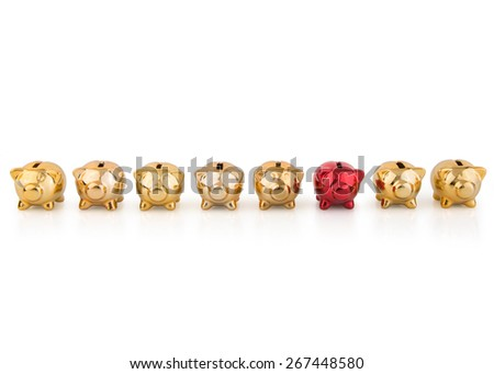 group of gold Piggy Banks in a  row with one red - stock photo