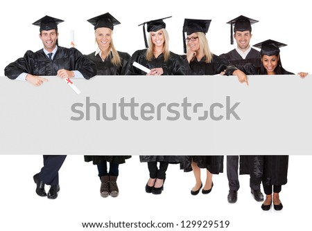 Group of graduate students presenting empty banner. Isolated on white