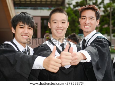 Group of graduate students standing show thumb up outdoors
