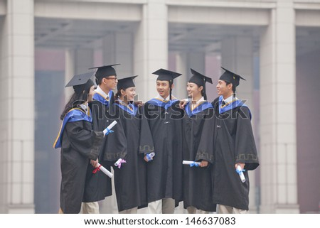 Group of Graduate Students Standing Together with Diplomas