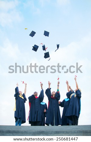 group of graduates celebrating outdoors