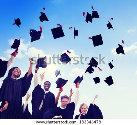 Group Of Graduating Student Throwing Caps In The Air - stock photo