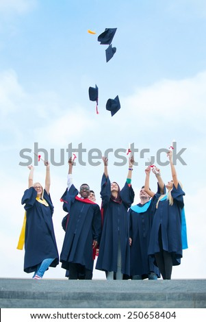 Group Of Graduating Students Throwing Caps in The Air  - stock photo