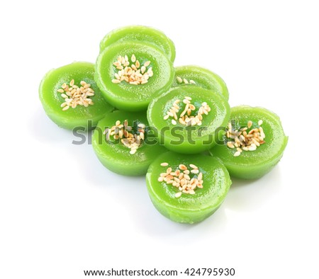 Group of green multiple scented sesame chinese sweet on white floor.
