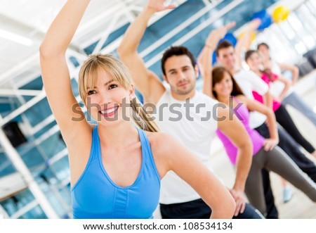 Group of gym people in aerobics class - stock photo
