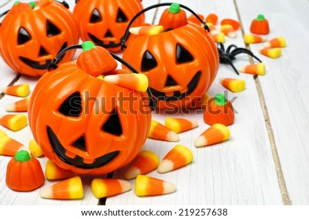 Group of Halloween Jack o Lantern candy holders with candy corn on wood