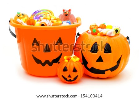 Group of Halloween Jack of Lantern candy holders over white - stock photo