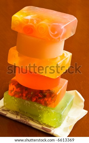 group of handmade soaps on brown table - stock photo