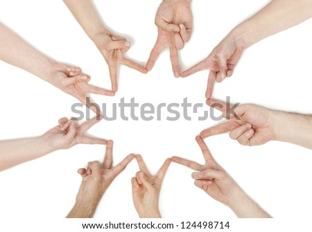 Group of hands forming a star shape isolated in a white background - stock photo
