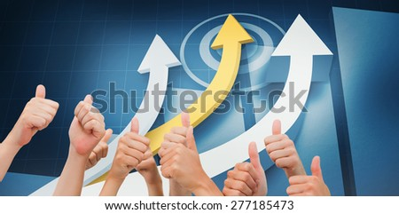 Group of hands giving thumbs up against digital blue background with arrows