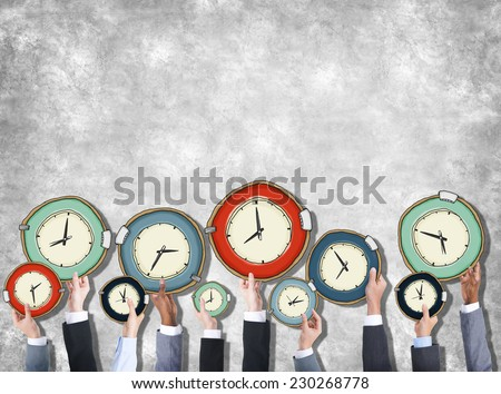 Group of Hands Holding Clock - stock photo