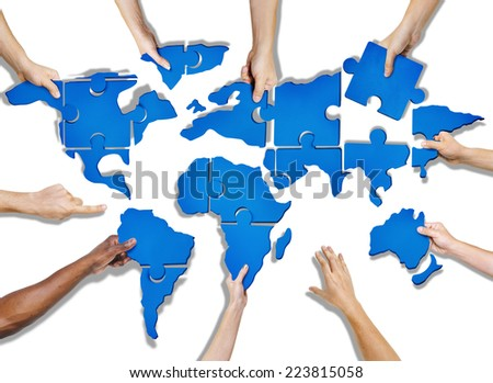 Group of Hands Holding Jigsaw Puzzle Forming World - stock photo