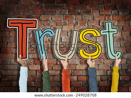 Group of Hands Holding Letter Trust - stock photo