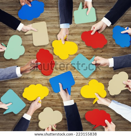 Group of Hands Holding Speech Bubble - stock photo