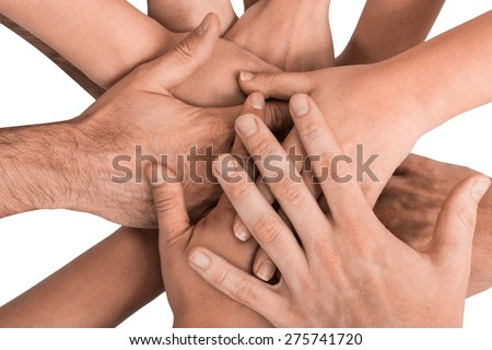 Group of hands holding together on white background. - stock photo