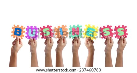 group of hands holding word business - stock photo