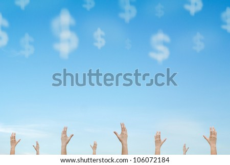 group of hands reaching out cloud money falling from sky - stock photo