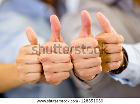 Group of hands with thumbs up expressing positivity - stock photo