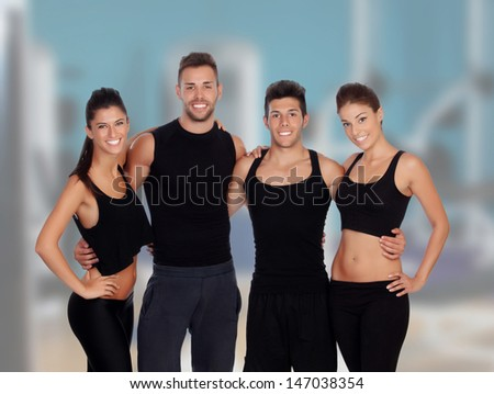Group of handsome guys and pretty girls in the gym - stock photo
