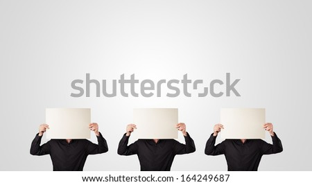 Group of handsome men in suit gesturing with empty cardboard