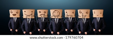Group of handsome people gesturing with sketched smiley faces on box