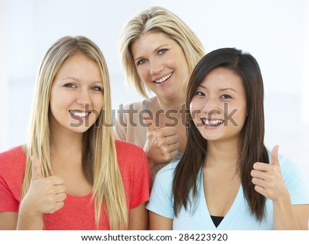 Group Of Happy And Positive Businesswomen In Casual Dress Making Thumbs Up Gesture - stock photo