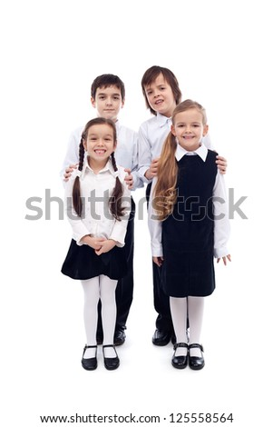 Group of happy and well groomed elementary school kids - isolated